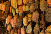 Buddha head masks and carvings — Stock Photo