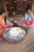 Village women preparing fermented sour fish — Stock Photo