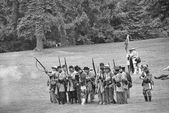 Confederate infantry line firing a volley. — Stock Photo