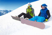 Couple snowboarders in a ski resort — Stock Photo