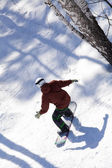 Snowboarder slides from the mountain — Stock Photo