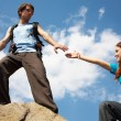 Hiker reaches hand to woman — Stock Photo #53710789