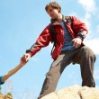 Hiker reaches hand to woman — Stock Photo #53710801