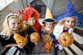 Children in halloween costumes — Stock Photo