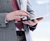 Male hands touching digital tablet — Stock Photo