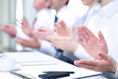 Hands applauding at meeting — Stock Photo