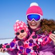 Woman with cute little girl in wintertime — Stock Photo #54801749