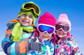 Children playing on snow — Stock Photo