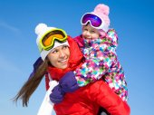 Woman with cute little girl in wintertime — Stock Photo