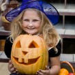 Girl in a witch costume — Stock Photo #55320807