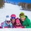Family on ski resort — Stock Photo #57848115
