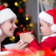 Mom and daughter in Christmas — Stock Photo #58669771