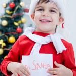 Boy holding letter to Santa — Stock Photo #58670019