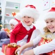 Children in Christmas hat with presents — Stock Photo #58670053