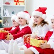 Children in Christmas hat with presents — Stock Photo #58670137