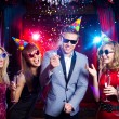 Cheerful young people with confetti — Stock Photo #69532433