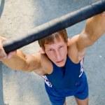 Male athlete on bar — Stock Photo #69533341