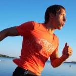 Man running on beach — Stock Photo #69533373