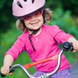 Little girl in helmet on bicycle — Stock Photo #69533619