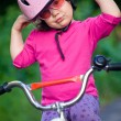 Little girl in helmet on bicycle — Stock Photo #69533639