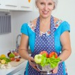 Woman cooking dinner — Stock Photo #70903945