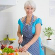 Woman cooking dinner — Stock Photo #70903955