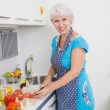 Woman cooking dinner — Stock Photo #70903969