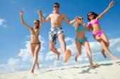 Happy people on beach — Stock Photo