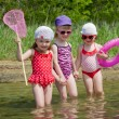 Three little girls go into the water — Stock Photo #76059639