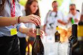 Waiter uncorked bottle of wine — Stock Photo