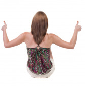 Woman gesturing thumbs up — Stock Photo