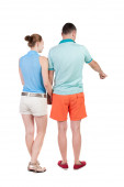 Pointing young couple Back view — Stock Photo