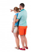 Pointing young couple Back view — Foto de Stock