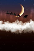 Santa Claus is flying on a background of the moon  — Fotografia Stock