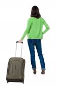 Back view of woman with suitcase. — Stock Photo