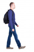 Walking man with backpack — Stock Photo