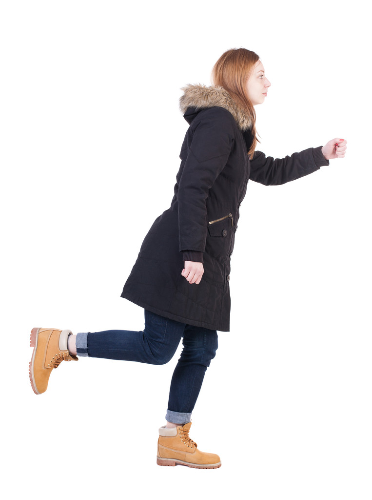 Young running woman in parka — Stock Photo