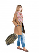 Walking  woman  with suitcase — Stock Photo