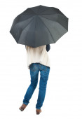 Young woman under an umbrella. — Stock Photo