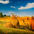 Autumn landscape in a mountain village — Stock Photo #62212813