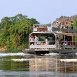 Tourists on the White Nile River in Uganda — Stock Photo #76271135