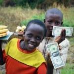 Uganda, young sellers of bananas — Stock Photo #77851746