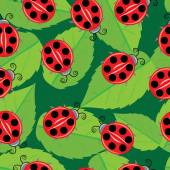 Seamless pattern with ladybugs — Stock Vector