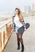 Beautiful female Skateboarder — Stock Photo