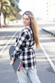 Beautiful female Skateboarder — Foto Stock