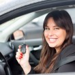 Woman driving new car — Stock Photo #71536837
