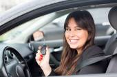 Woman driving new car — Stock Photo