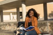 Happy female student relaxing — Stock Photo