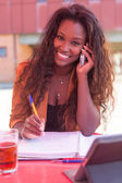 African woman at the phone — Stock Photo