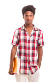 African student holds books in hand — Stock Photo